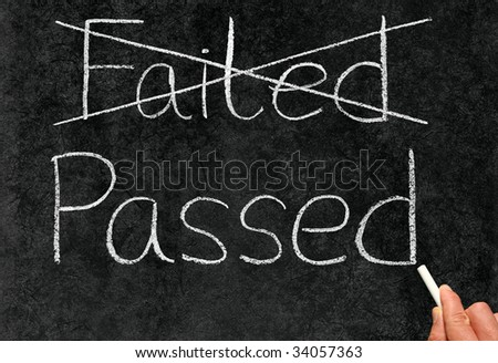 Crossing out failed and writing passed on a blackboard.