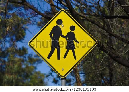 Crossing sign in yellow colored rhombus diamond shape #1230195103