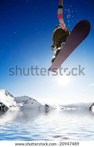 Crossover snowboard, surfing photo with boarder jumping into water