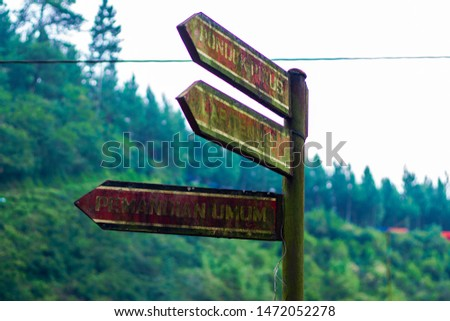 Crossroad signpost saying this way, that way, the other way concept for lost, confusion or decisions #1472052278