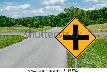 Crossroads Sign:  A road sign warns of an intersection ahead.