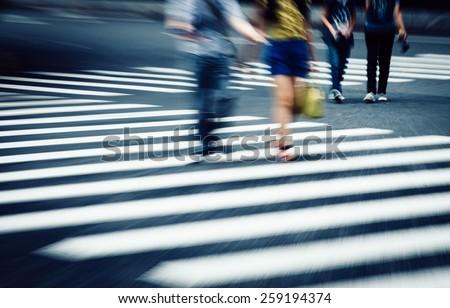crosswalk and pedestrian at modern city zebra crossing street, blur abstract
