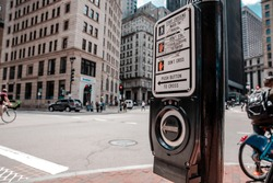 Crosswalk Pedestrian Signal Button and Sign push button with sign turning vehicles area downtown in Boston, USA