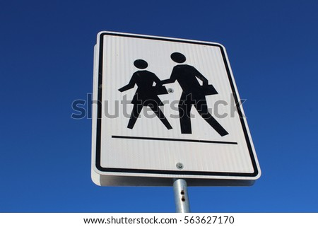 Crosswalk Sign Against Blue Sky