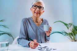 Crosswords. Cognitive rehabilitation therapy for senior women.