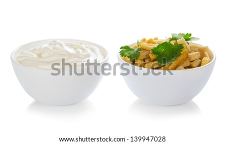 Croutons and bowl with the sour cream, isolated on white