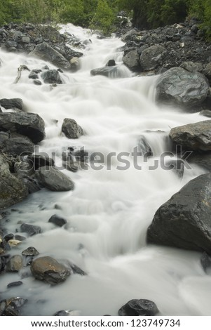 Crow Pass Creek rushes down a mountain side in the Chugach National Forest near Girdwood, Alaska