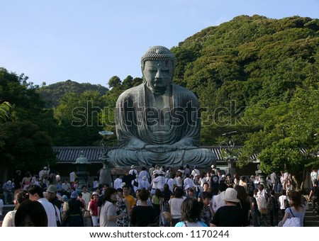 crowd before the giant statue of japanese Buddha in Kamakura Japan