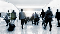 crowd of anonymous blurred business people at a tradeshow