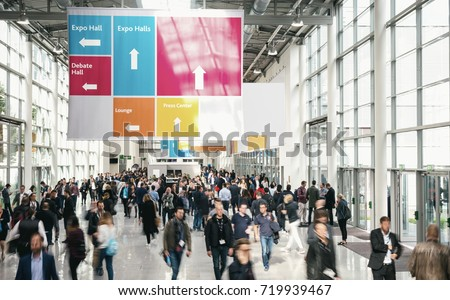 Crowd of anonymous Business people walking at a trade fair