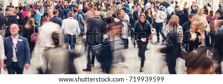 Crowd of anonymous people walking