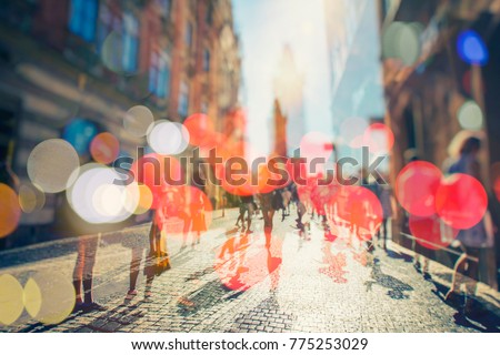 Stock Photo Crowd of anonymous people walking on busy city street