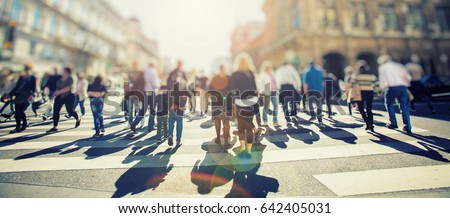 Crowd of anonymous people walking on busy city street, urban city life background #642405031