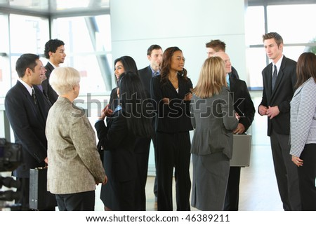 Crowd of businesspeople in lobby
