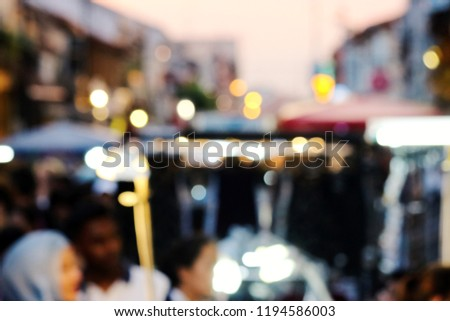 Crowd of Indian people are buying their shirts at the old fashion shopping street, as blurred defocus effect. #1194586003