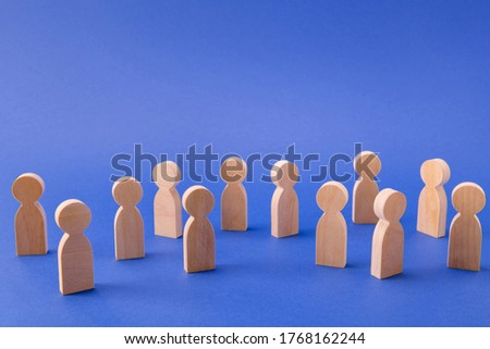 Crowd of many faceless people figures similar same social layer walking living lonely life alone in big city psychology isolated over bright vivid shine vibrant blue color background