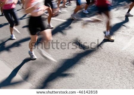 Crowd of marathon runners with motion blur to accent speed