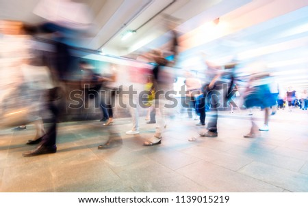 Crowd of People as Pedestrians in Metro, blurred Picture as Background #1139015219