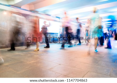 Crowd of People as Pedestrians in Metro, blurred Picture as Background #1147704863