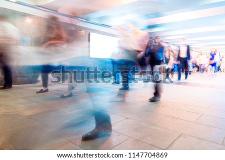 Crowd of People as Pedestrians in Metro, blurred Picture as Background