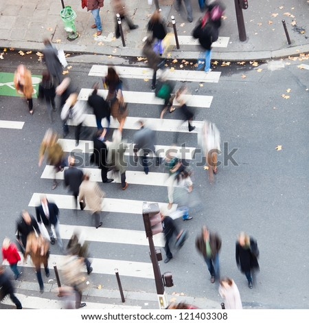 crowd of people crossing the street on the zebra crossing