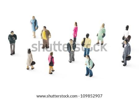 Crowd of people in miniature dolls.