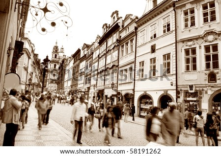Crowd of people in streets of Prague. Sepia version. - stock photo