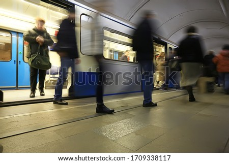 Photo of  crowd of people metro in motion blurred, abstract background urban traffic people