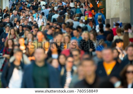 Crowd of people on the street. No recognizable faces
