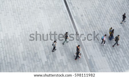 crowd of people walk on open...