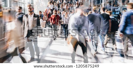 Crowd of people walking on a street in london