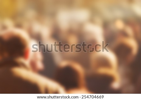 Crowd of People Walking On the Street in Bokeh, unrecognizable group of men and women as blur urban background.