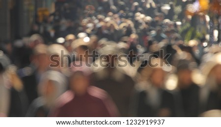 Crowd of people walking street #1232919937