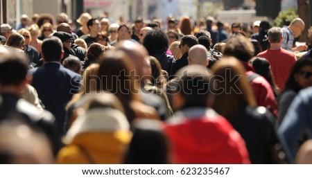 Crowd of people walking street #623235467