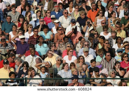 Crowd of people watching a high  school graduation. Editorial use only.