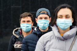 Crowd of people wearing medical masks. Coronavirus epidemic concept. Group of young volunteers outdoors. Coronavirus quarantine. Global pandemic. Worldwide coronavirus outbreak.
