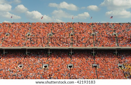Crowd of thousands dresses in orange - stock photo