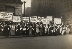 Crowd of women's suffrage supporters demonstrating with signs reading, 'Wilson Against Women,' in Chicago on October 20, 1916. Wilson withheld his support for Votes of Women until 1918.