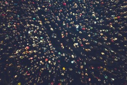crowd people background. An aerial shot of the people gathered for an event. Crowed open-air meeting people shot from a height. A mass people gathered to celebrate an event. Open-air night festival.