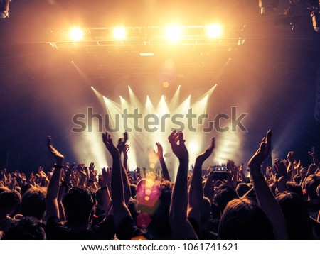 Crowd point of view inside a concert hall
