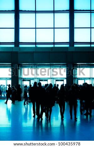 crowd silhouette inside modern building