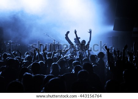 Crowd surfing during a musical performance #443156764