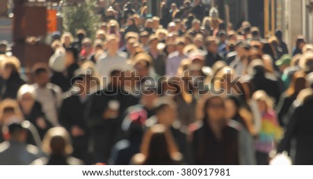 Crowd walking street anonymous blurred face New York City #380917981