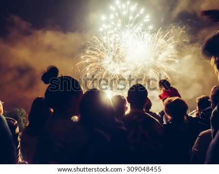Crowd watching fireworks and celebrating