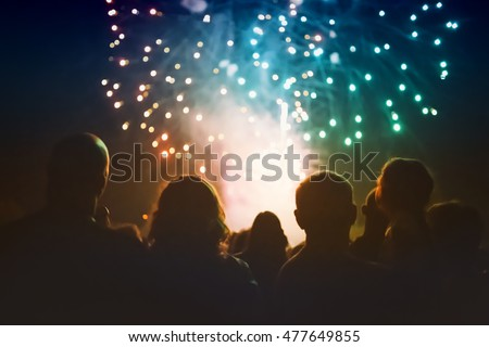 Crowd watching fireworks and celebrating #477649855