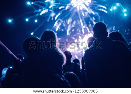 Crowd watching fireworks and celebrating new year eve #1233909985