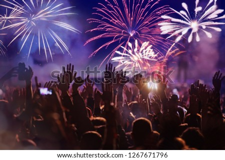 crowd watching fireworks - New Year celebrations- abstract holiday background