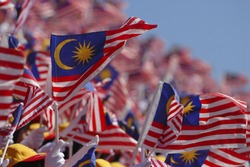 Crowd waving Malaysian flag