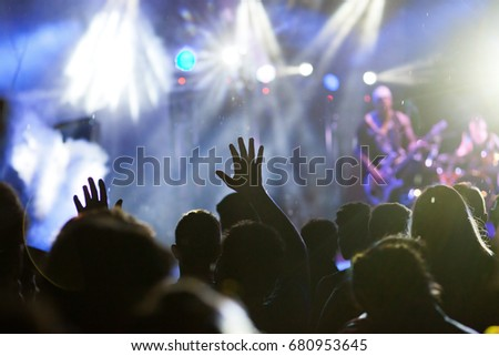 crowd with raised hands at concert - summer music festival #680953645