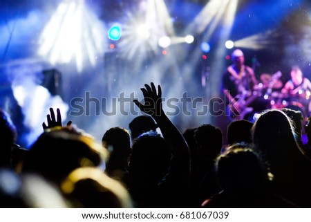 crowd with raised hands at concert - summer music festival #681067039
